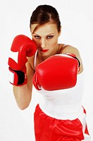 Young female boxer, forward punch