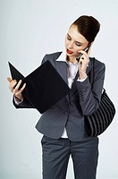 Young businesswoman, female manager with purse making a phone call