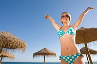 Stylish teenage girl posing on beach (thumbnail)