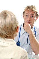 Medical consultation. Doctor in discussion with his young patient.