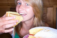 Close up of girl eating victorian sponge cake