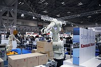 Industrial production line robot moving packed goods. This is the FD_50N robot from the Kawasaki Robot company, Japan. This robot is on display at IRE...