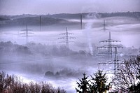 DEU Germany Bochum : High Voltage electrical power lines between Essen Bochum morning fog. ,