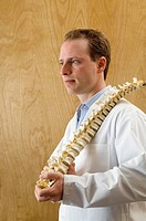 Chiropractor with a spine model