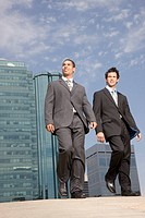 Two businessman walking outside