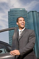 Businessman getting in car