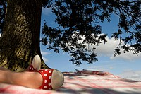 Girl relaxing under tree