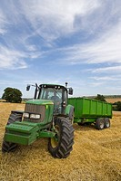 Tractor in barley field