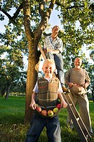 Three generations of men picking apples, close_up of boy 9_11 smiling
