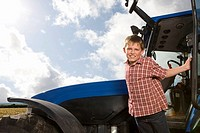 Portrait of boy leaning out of tractor