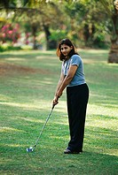 Lady holding putter with ball MR382
