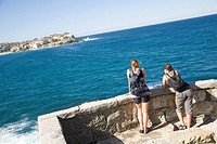 Women resting on walk between Bondi Beach and Bronte Beach, Sydney, New South Wales, Australia