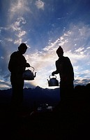 Porters preparing early morning tea, Inca trail, Peru