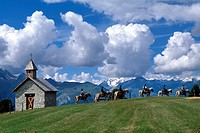 Tourists riding on horses with mountain range in background, Hohe Tauern, Alps, Moelltal, Carinthia, Austria