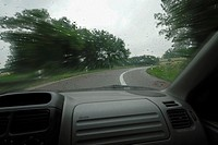 Right turn along a wet road, in-car perspective