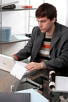 Young man working at desk