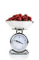 Kitchen scale filled with strawberries