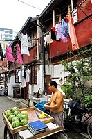 Old part of town, street scene, merchant selling melons, Shanghai, China, Asia