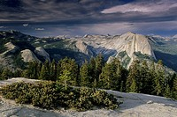 Sunset light thru storm clouds on Half Dome and Tenaya Canyoon, from Sentinel Dome, Yosemite National Park, CALIFORNIA