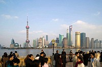 China. Shanghai. Shanghai City: Pudong District. Visitors on the Bund waterfront with view of Pudong
