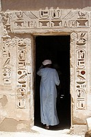 Upper Egyptian man inter a chamber in Medinet Habu Temple, Luxor, Egypt