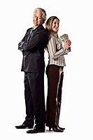 Business man and business woman holding cash in hands in studio white background Denver, Colorado, USA