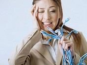 Frustrated Businesswoman Holding Computer Cables