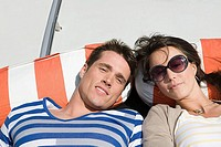 Couple sunbathing on a boat