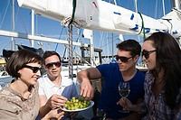 Friends eating grapes on a boat