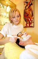 Woman getting a facial in a beauty parlour