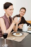People having coffee at a dinner party