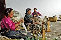 Tibetan women with a archaic spinning wheels, carpet manufacture, Shigatse, Tibet, Asia