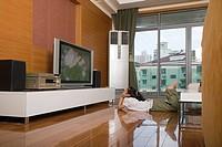 A girl watching tv