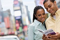 Couple Looking at Guide Book