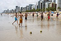 Boys playing beach soccer with coconut goal posts, Recife, Pernambuco, Brazil, South America