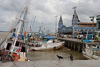 Fishing Boats and vultures in the harbour outside Mercado Ver O Peso Market, Belem, Para, Brazil, South America