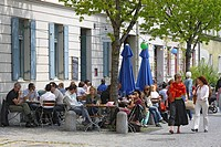 People sitting at outdoor seating of the restaurant Am Kloster, Haidhausen, Munich, Bavaria, Germany