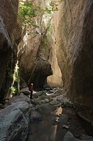Person hiking through Avakas Gorge, Akamas Nature Reserve Park, South Cyprus, Cyprus