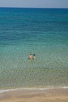 Two women swimming in the sea, Salamis Beach, Mimoza Beach Hotel, Salamis, Cyprus