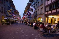 People sitting outside a cafe bar in the Muenstergasse, Old City of Berne, Berne, Switzerland