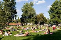 People sunbathing in the Zurich China Garden on the right bank of Lake Zurich, Zurich, Switzerland