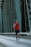 Runner on Hawthorne Bridge, Portland, race from Mount Hood to the coast, Oregon, USA