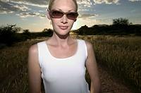 Young woman with sunglasses, Okomitundu farm, Okahandja, Namibia, Africa