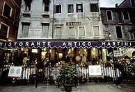 People sitting at outdoor seating of Restaurant Antico Martini, Venice, Italy