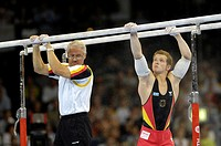 Artistic Gymnastics Fabian HAMBUeCHEN GER and father and coach Wolfgang on parallel bars Artistic Gymnastics World Championships 2007 Stuttgart Baden_...