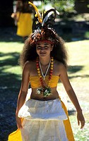 Young woman in traditional dress, dance of welcome in the village of Hakahau on the Island of Ua Pou, French Polynesia
