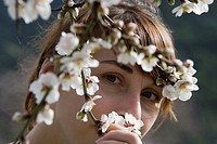 Woman Admiring Almond Tree Blossoms, Near Randa, Mallorca, Balearic Islands, Spain