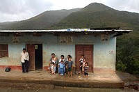 Family in front of their house in the mountains around Zomba, Ecuador, South America