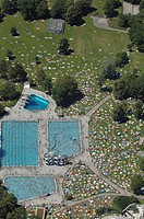 Aerial view, open_air bath ´Michaelibad´, swimming pool with water slide and sunbathing area, Munich, Bavaria, Germany