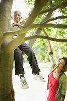 Mother and son playing in tree